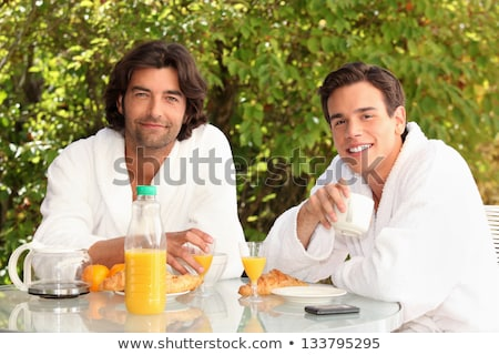 45 years old man and a 20 years old man dressed in bathrobe drinking coffee at breakfast Stock photo © photography33