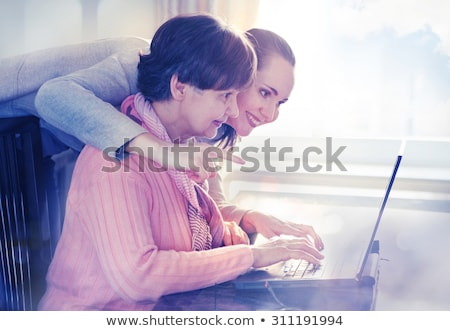 Stock photo: Woman helping grandmother with computer