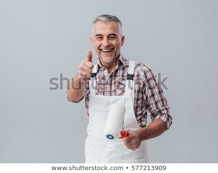 cheerful decorator with a paint roller stock photo © photography33