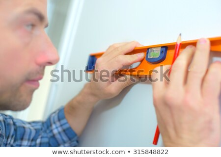 man using spirit level to check wall stock photo © photography33