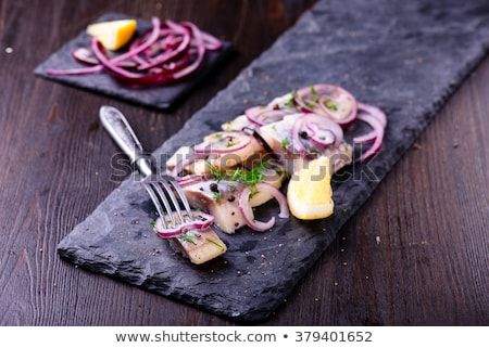 sliced herring with vegetables stock photo © shutswis