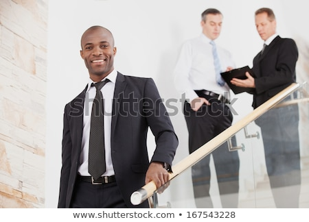 Young Black Man on Steps looking at Camera stock photo © Schmedia