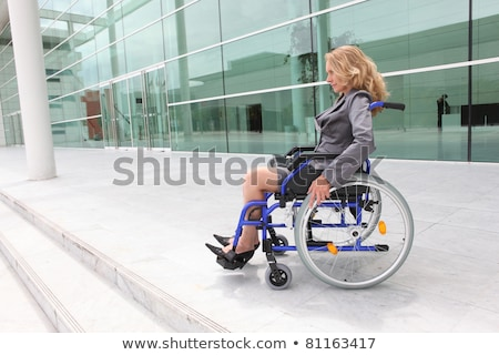 Woman in a wheelchair outside an office building Stock photo © photography33