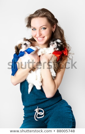 Portrait of beautiful blonde with two dogs. Isolated Stock photo © acidgrey