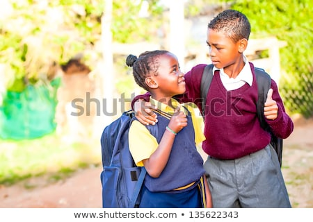 Cheerful school boy showing his thumbs up stock photo © get4net