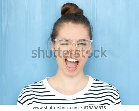 Close up of a playful girl looking up against a white background Stock photo © wavebreak_media
