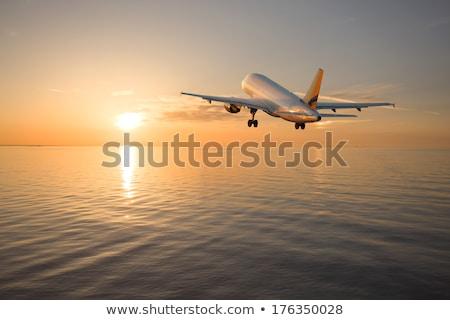 Avião pôr do sol militar transporte brilhante indústria Foto stock © Gordo25
