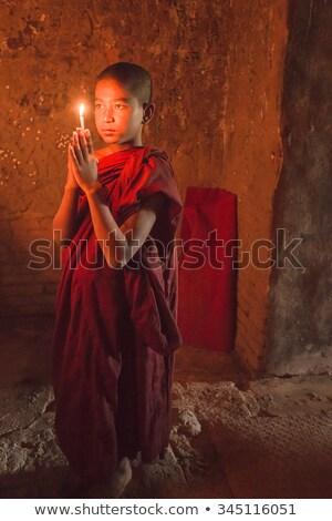Kicsi imádkozik gyertyafény gyerekek szemek gyerek Stock fotó © szefei
