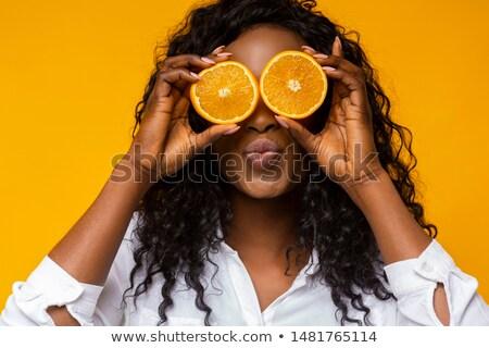 Beautiful woman with sliced orange Stock photo © wavebreak_media