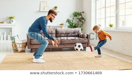 oldalnézet · kicsi · fiú · rúg · futball · fehér - stock fotó © wavebreak_media