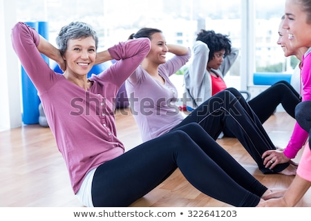 Portrait of young  woman stretching on hardwood floor Stock photo © wavebreak_media