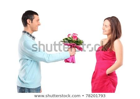 Fiatal felnőtt férfi felajánlás rózsa barátnő vízszintes Stock fotó © tab62