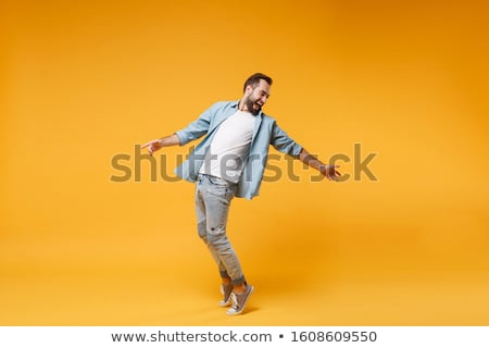 full length of casual man on toes Stock photo © feedough