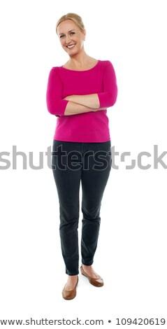 Mulher em pé dobrado brasão belo Foto stock © fantasticrabbit