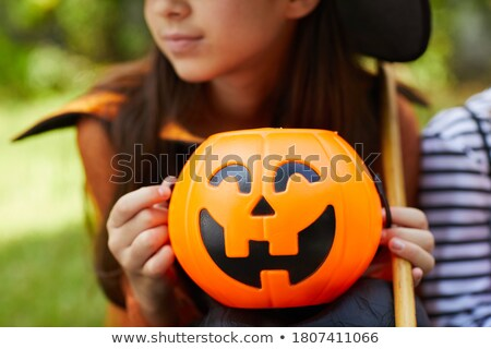 beautiful witch holding jack lantern oranges stock photo © elisanth