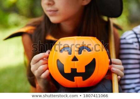 Beautiful witch holding Jack lantern oranges  Stock photo © Elisanth