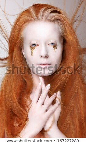 Masquerade. Redhead Woman with Futuristic Make-up. Fantasy Stock photo © gromovataya