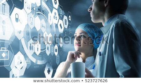 female medical doctor working with healthcare icons stock photo © hasloo