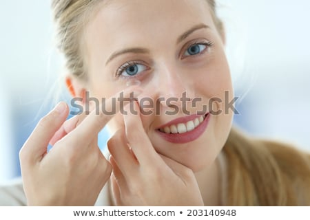 Woman with contact lense Stock photo © w20er