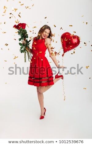 happy smiling beautiful woman holding red heart over bouquet of stock photo © victoria_andreas