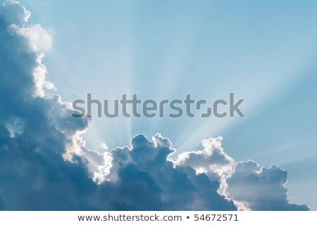sun burst surreal sun rays with cloud stock photo © frameangel