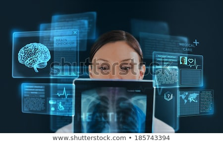 female medicine doctor working with modern computer interface as stock photo © hasloo
