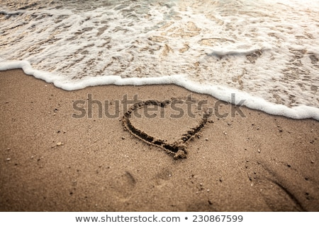 Hheart drawn in sand being washed by the sea Stock photo © lightpoet