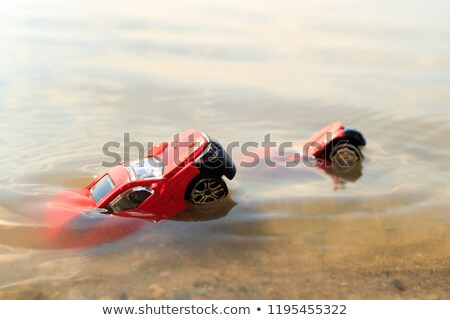 Stick floating in heavy rain on road Stock photo © backyardproductions