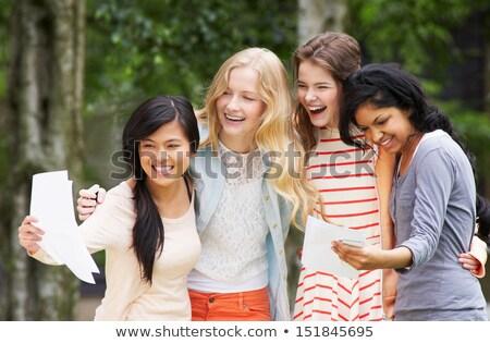 Négy tinilányok ünnepel sikeres vizsga eredmények Stock fotó © monkey_business