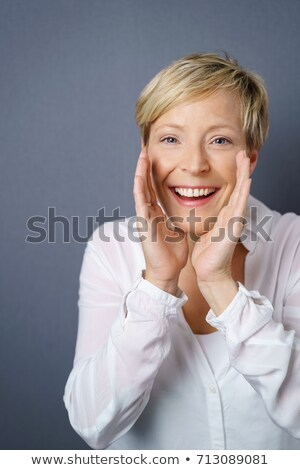 woman shouting with hands cupping mouth stock photo © bmonteny