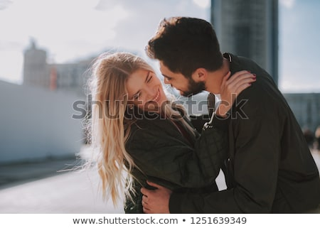 Blonde woman looking away and embracing her boyfriend Stock photo © feedough