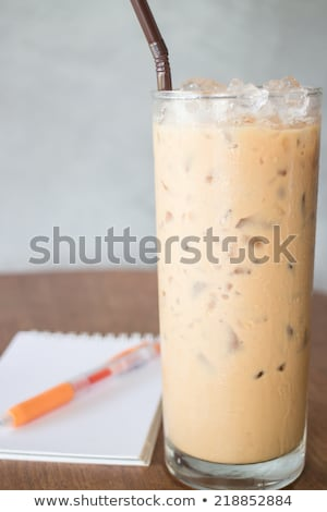 Cold milk coffee and notepaper on wooden table Stock photo © nalinratphi