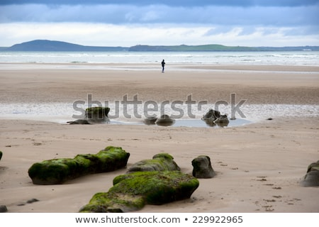 girl walking near unusual mud banks Stock photo © morrbyte