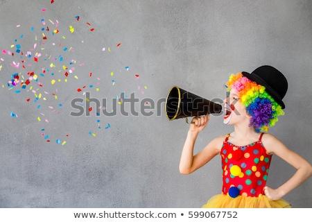 Clown shouting at the megaphone Stock photo © HASLOO