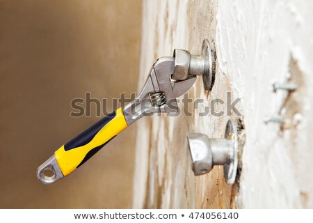 Plumber Mending Tap With Adjustable Wrench Stock photo © HighwayStarz