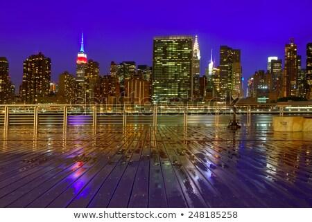 Manhattan Нью-Йорк Skyline дождливый реке ночь Сток-фото © lunamarina