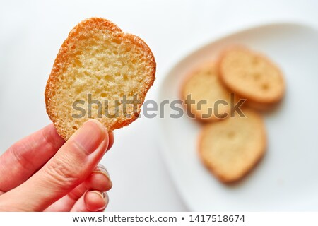 freshly baked rusk with a grip  Stock photo © peter_zijlstra