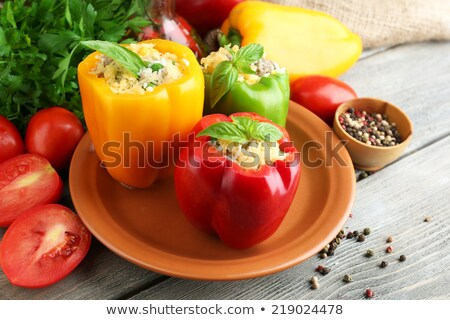 preparing a yellow bell pepper on kitchen table stock photo © shawnhempel