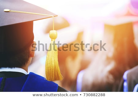 Young people graduated in graduation gowns and mortarboards Stock photo © vectorikart