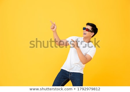 shocked young man pointing finger up stock photo © deandrobot