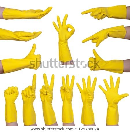 Handen rubberen handschoenen vuist geïsoleerd witte Stockfoto © michaklootwijk
