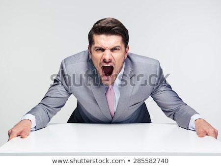 Young angry businessman shouting at camera Stock photo © wavebreak_media