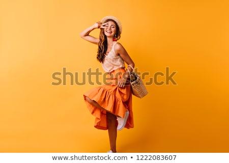 оранжевый юбка ног высокий женщину моде Сток-фото © Bigalbaloo