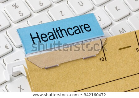 A brown file folder labeled with Healthcare Stock photo © Zerbor
