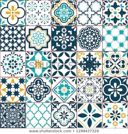 Green decorative portuguese tiles Stock photo © elxeneize