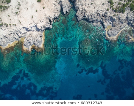 Tropical reef and rocky cliff Stock photo © Kacpura
