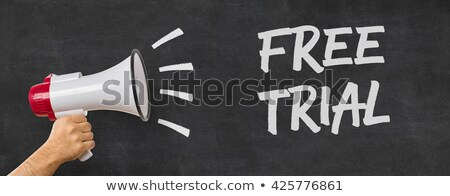 a man holding a megaphone   free trial stock photo © zerbor