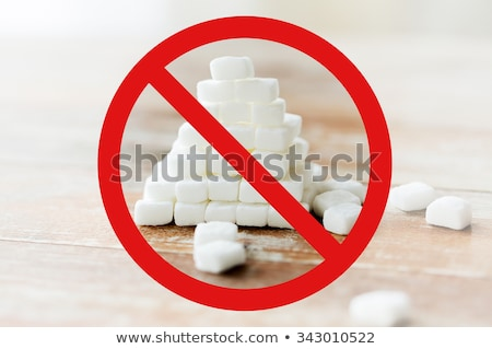 Stock photo: close up of white sugar pyramid on wooden table