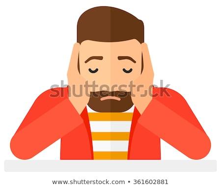 Man in despair clutching his head. Stock photo © RAStudio