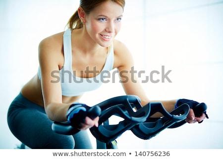 Fitt nő képzés fitnessz tornaterem aranyos Stock fotó © Aikon